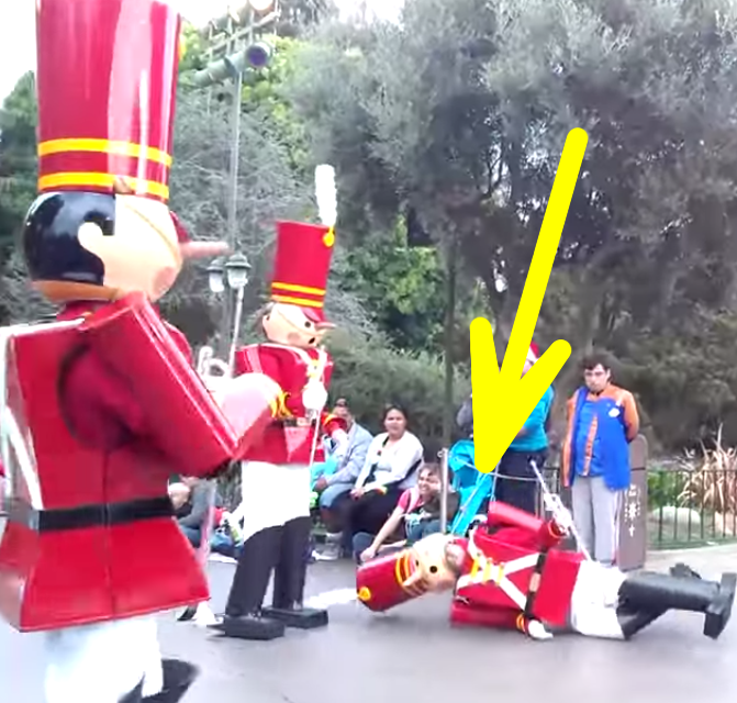 disneys christmas parade toy soldier takes a nosedive