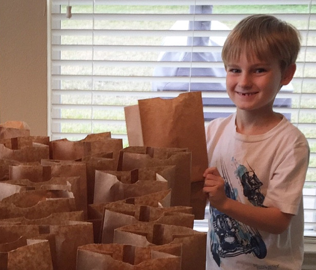 This Kid Made $120 and Spent it Feeding the Homeless.