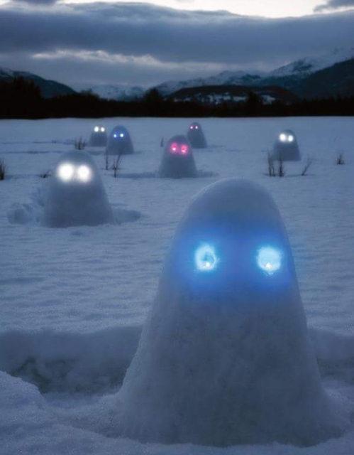 Adding Glowsticks Makes Snowmen Extra Creepy