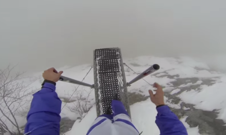 BASE Jumping into a Foggy Abyss in Switzerland.