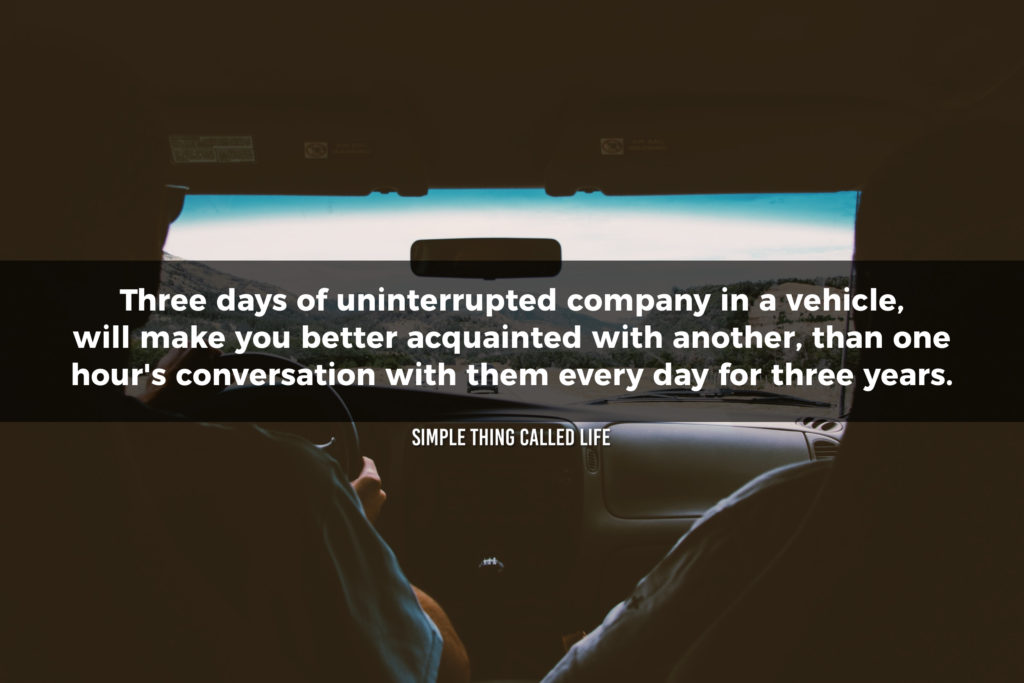 """A picture of two people driving in a car overlayed with the quote """"Three days of uninterrupted company in a vehicle, will make you better acquainted with another, than one hour's conversation with him every day for three years."""""""