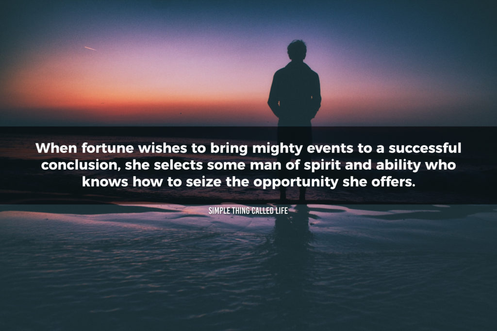 """A picture of a man standing in an ocean watching the sunset with the quote """"When fortune wishes to bring mighty events to a successful conclusion, she selects some man of spirit and ability who knows how to seize the opportunity she offers."""""""
